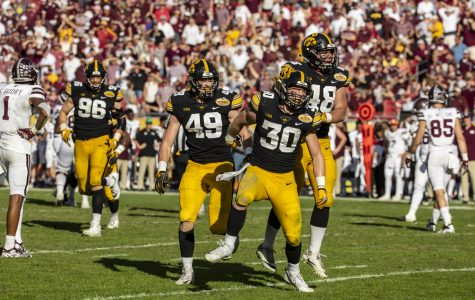 Back-and-forth Outback Bowl swings Iowa's way