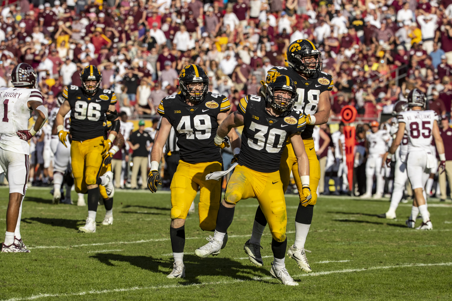 Iowa safety Jake Gervase celebrates after breaking up a pass to seal Iowa's victory during the Outback Bowl game between Iowa and Mississippi State at Raymond James Stadium in Tampa, Florida on Tuesday, January 1, 2019. The Hawkeyes defeated the Bulldogs 27-22.