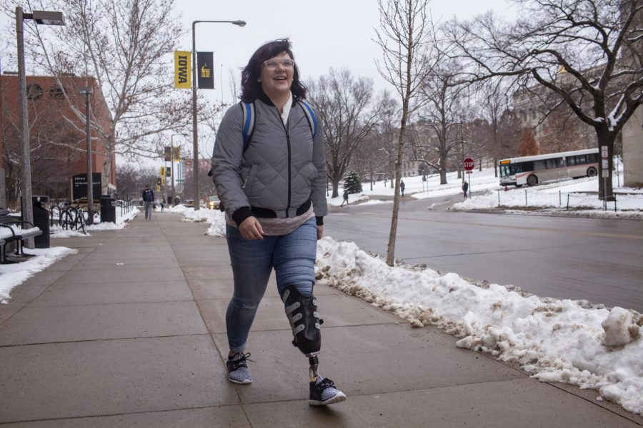 UI+senior+Erica+Cole+walks+on+campus+on+Tuesday%2C+January+15%2C+2019.+Cole+started+a+business+called+No+Limbits+which+creates+colorful+covers+for+amputees%27+prosthetics.+Cole+says+that+the+covers+have+shifted+the+conversations+she+experiences+about+her+prosthetic.