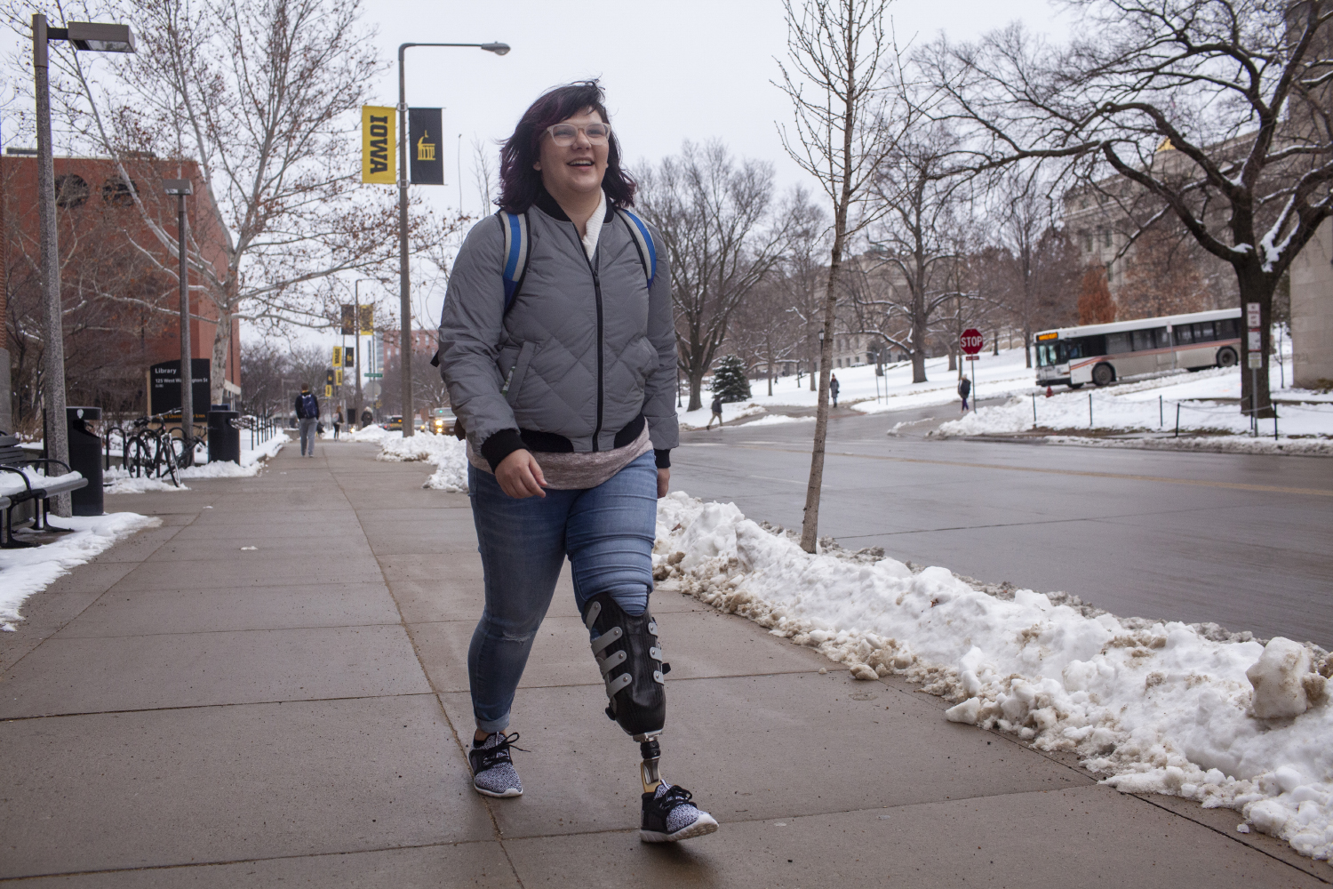 UI senior Erica Cole walks on campus on Tuesday, January 15, 2019. Cole started a business called No Limbits which creates colorful covers for amputees' prosthetics. Cole says that the covers have shifted the conversations she experiences about her prosthetic.