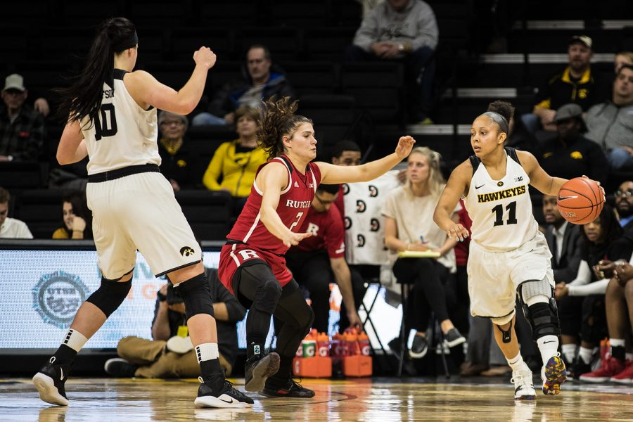 Iowa+guard+Tania+Davis+dribbles+through+the+defense+during+a+women%27s+basketball+matchup+between+Iowa+and+Rutgers+at+Carver-Hawkeye+Arena+on+Wednesday%2C+January+23%2C+2019.+The+Hawkeyes+defeated+the+Scarlet+Knights%2C+72-66.