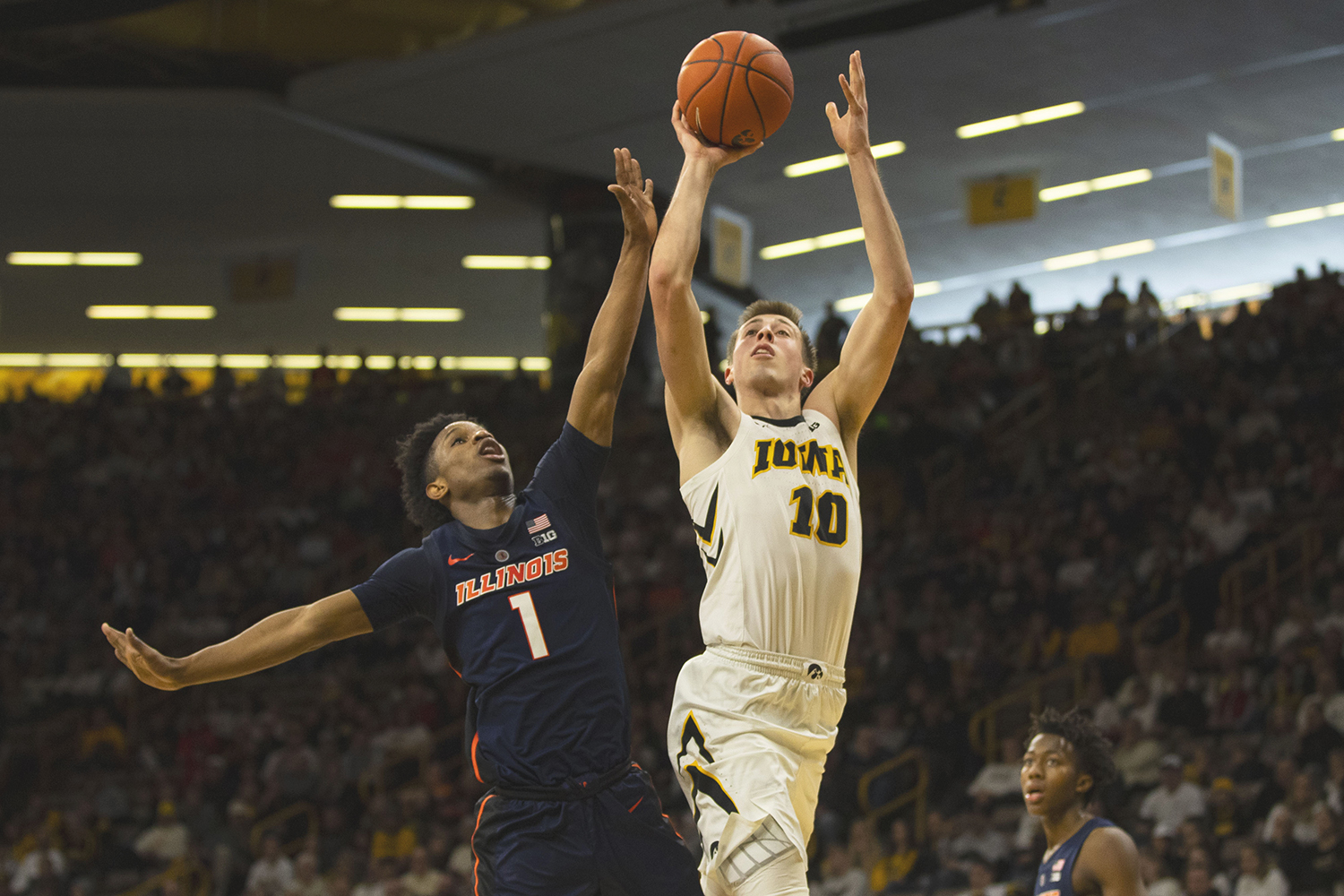 Iowa guard Joe Wieskamp attempts a shot during the Iowa/Illinois men's basketball game at Carver-Hawkeye Arena on Sunday, January 20, 2019. The Hawkeyes defeated the Fighting Illini, 95-71. (Lily Smith/The Daily Iowan)