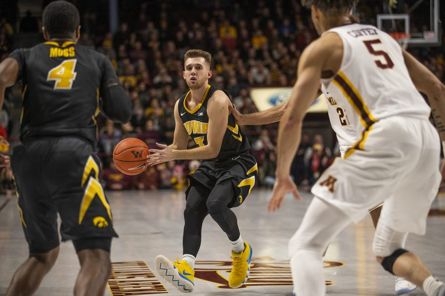 Iowa+guard+Jordan+Bohannon+readies+a+pass+against+Minnesota+at+Williams+Arena+on+Sunday.+The+Gophers+defeated+the+Hawkeyes%2C+92-87.+