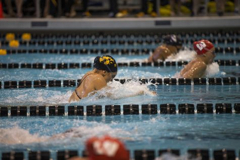 Iowa swimmer Devin Jacobs competes during the Northwestern/Wisconsin swim meet at the Campus Recreation and Wellness Center on Saturday, January 19, 2019. The men's swimming and diving team defeated the Badgers, 164-136, and the Wildcats, 194-106. The women's swimming and diving team fell to the Badgers, 191-109, and the Wildcats, 178-122.