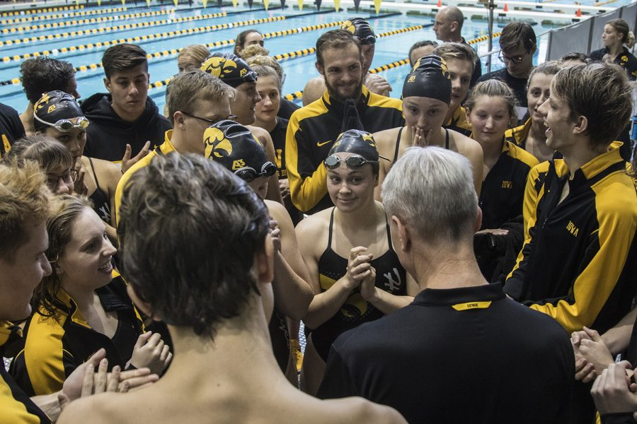 The+Iowa+swim+team+huddles+during+a+swim+meet+where+Iowa+hosted+the+University+of+Denver+and+University+of+Michigan+at+the+Campus+Recreation+and+Wellness+Center+on+Saturday%2C+November+3%2C+2018.+