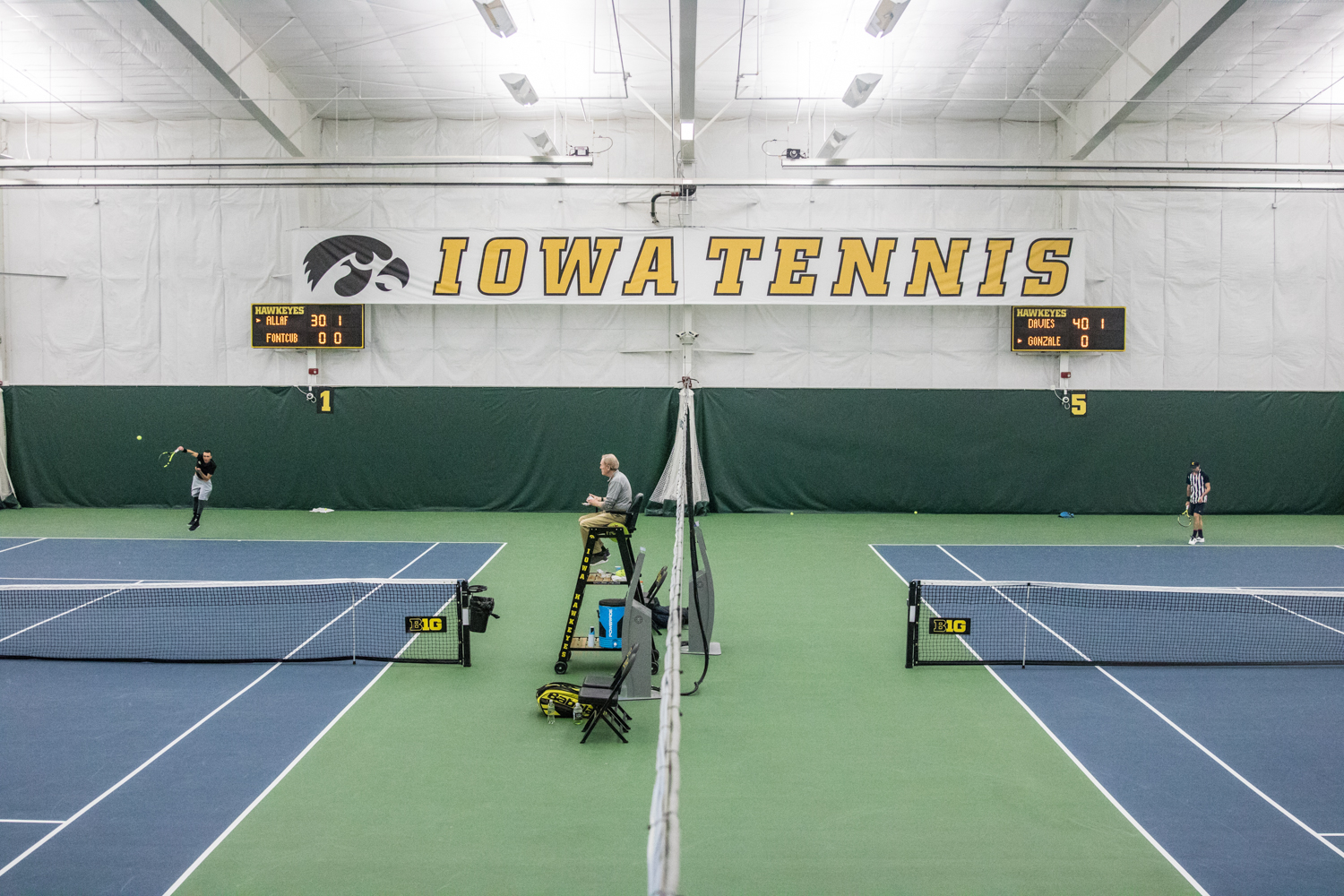 Singles+matches+are+underway+during+a+men%27s+tennis+match+between+Iowa+and+East+Tennessee+State+on+Friday%2C+January+25%2C+2019.+The+Hawkeyes+defeated+the+Buccaneers%2C+4-3.