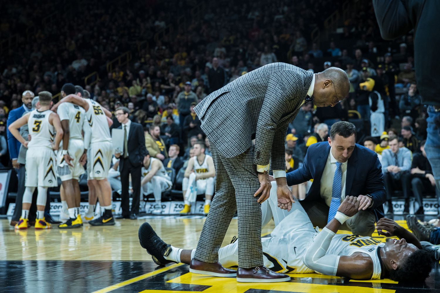 Trainers+tend+to+Iowa+forward+Tyler+Cook+during+a+men%27s+basketball+matchup+between+Ohio+State+and+Iowa+at+Carver-Hawkeye+Arena+on+Saturday%2C+January+12%2C+2019.+The+Hawkeyes+defeated+the+Buckeyes%2C+72-62.
