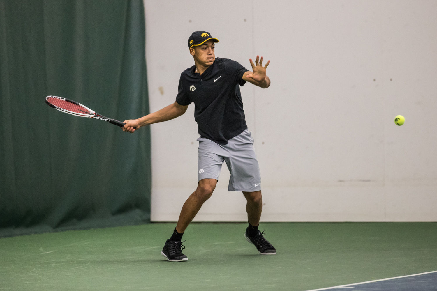 Iowa%27s+Oliver+Okonkwo+hits+a+forehand+during+a+men%27s+tennis+match+between+Iowa+and+East+Tennessee+State+on+Friday%2C+January+25%2C+2019.+The+Hawkeyes+defeated+the+Buccaneers%2C+4-3.