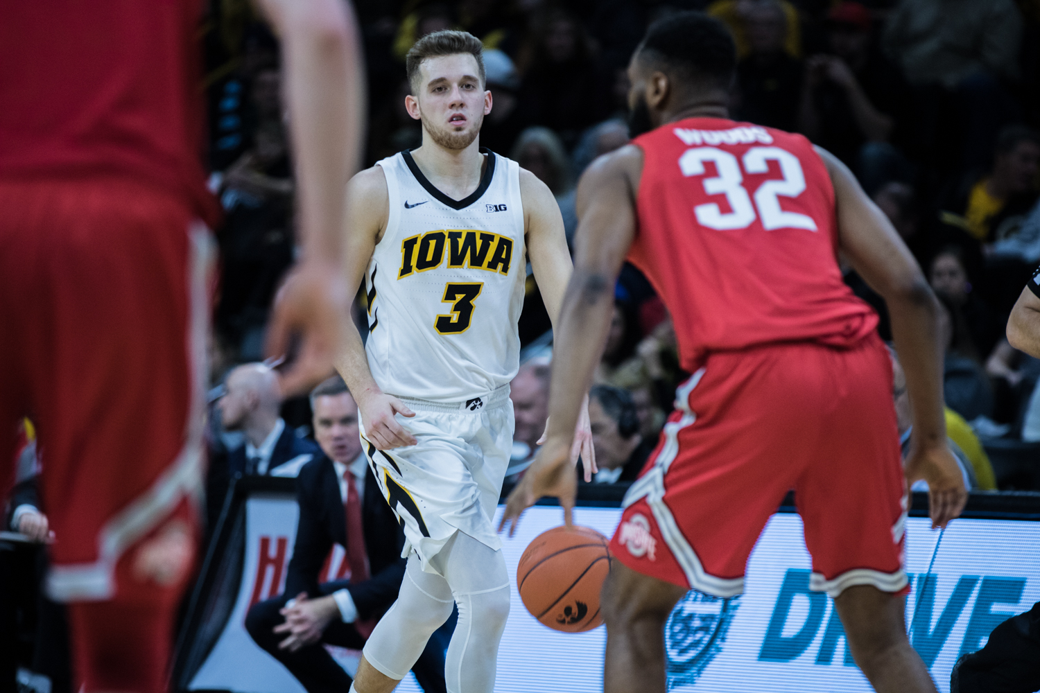 Iowa+guard+Jordan+Bohannon+surveys+the+defense+during+a+men%27s+basketball+matchup+between+Ohio+State+and+Iowa+at+Carver-Hawkeye+Arena+on+Saturday%2C+January+12%2C+2019.+The+Hawkeyes+defeated+the+Buckeyes%2C+72-62.