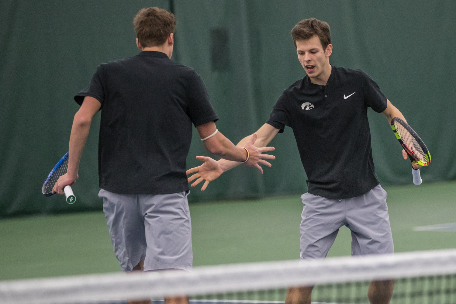 Iowa%27s+Piotr+Smietana+high-fives+Joe+Tyler+during+a+men%27s+tennis+match+between+Iowa+and+East+Tennessee+State+on+Friday%2C+January+25%2C+2019.+The+Hawkeyes+defeated+the+Buccaneers%2C+4-3.