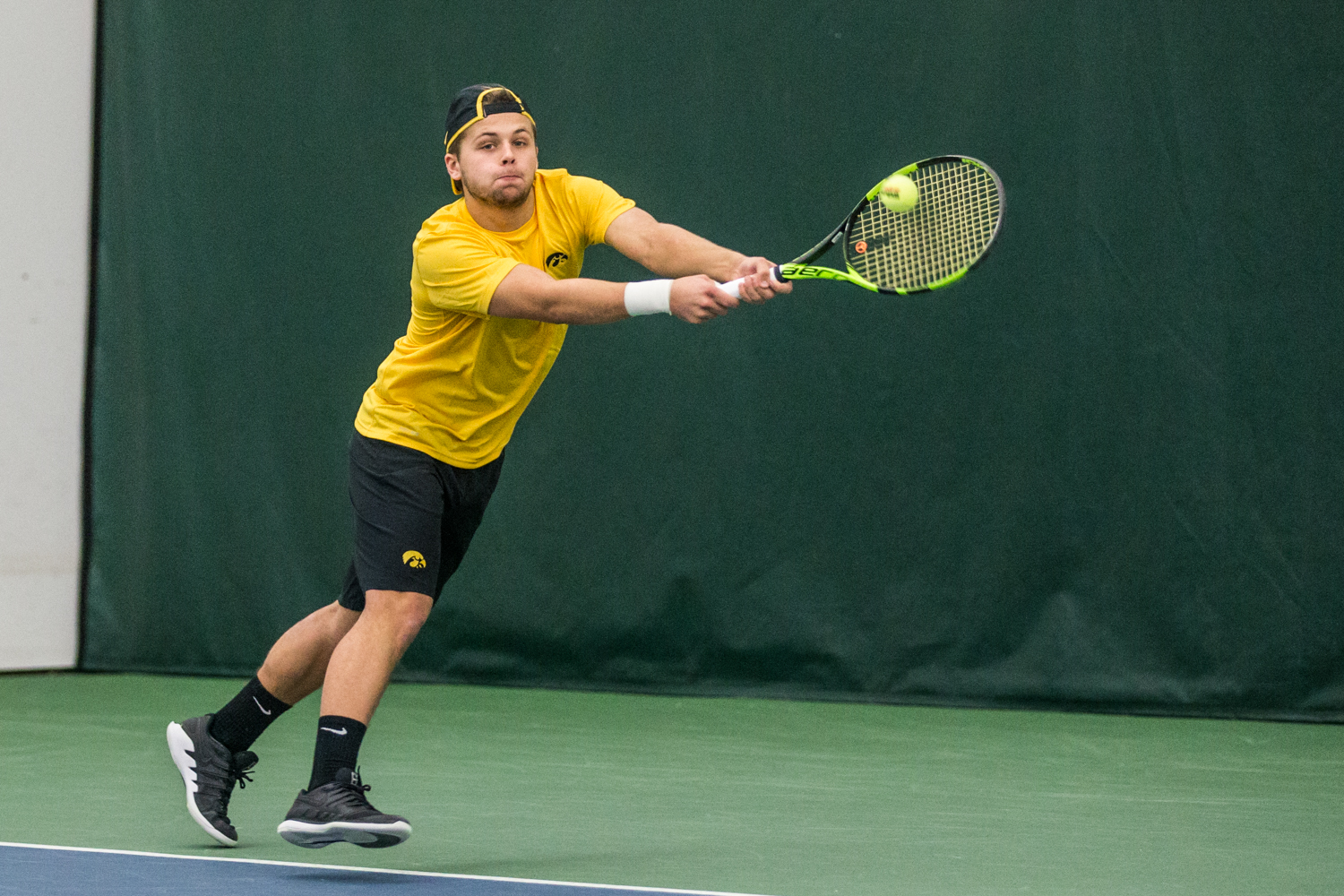 Iowa%27s+Will+Davies+hits+a+backhand+during+a+men%27s+tennis+matchup+between+Iowa+and+Butler+on+Sunday%2C+January+27%2C+2019.+The+Hawkeyes+defeated+the+Bulldogs%2C+5-2.