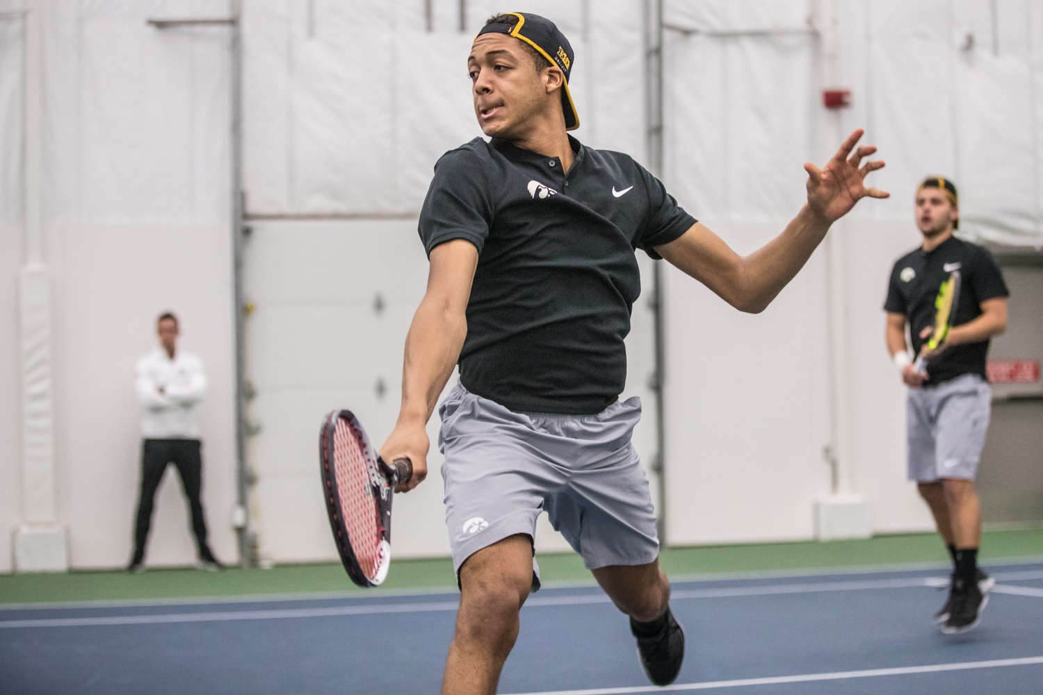 Iowa%27s+Oliver+Okonkwo+hits+a+volley+during+a+men%27s+tennis+match+between+Iowa+and+East+Tennessee+State+on+Friday%2C+January+25%2C+2019.+The+Hawkeyes+defeated+the+Buccaneers%2C+4-3.