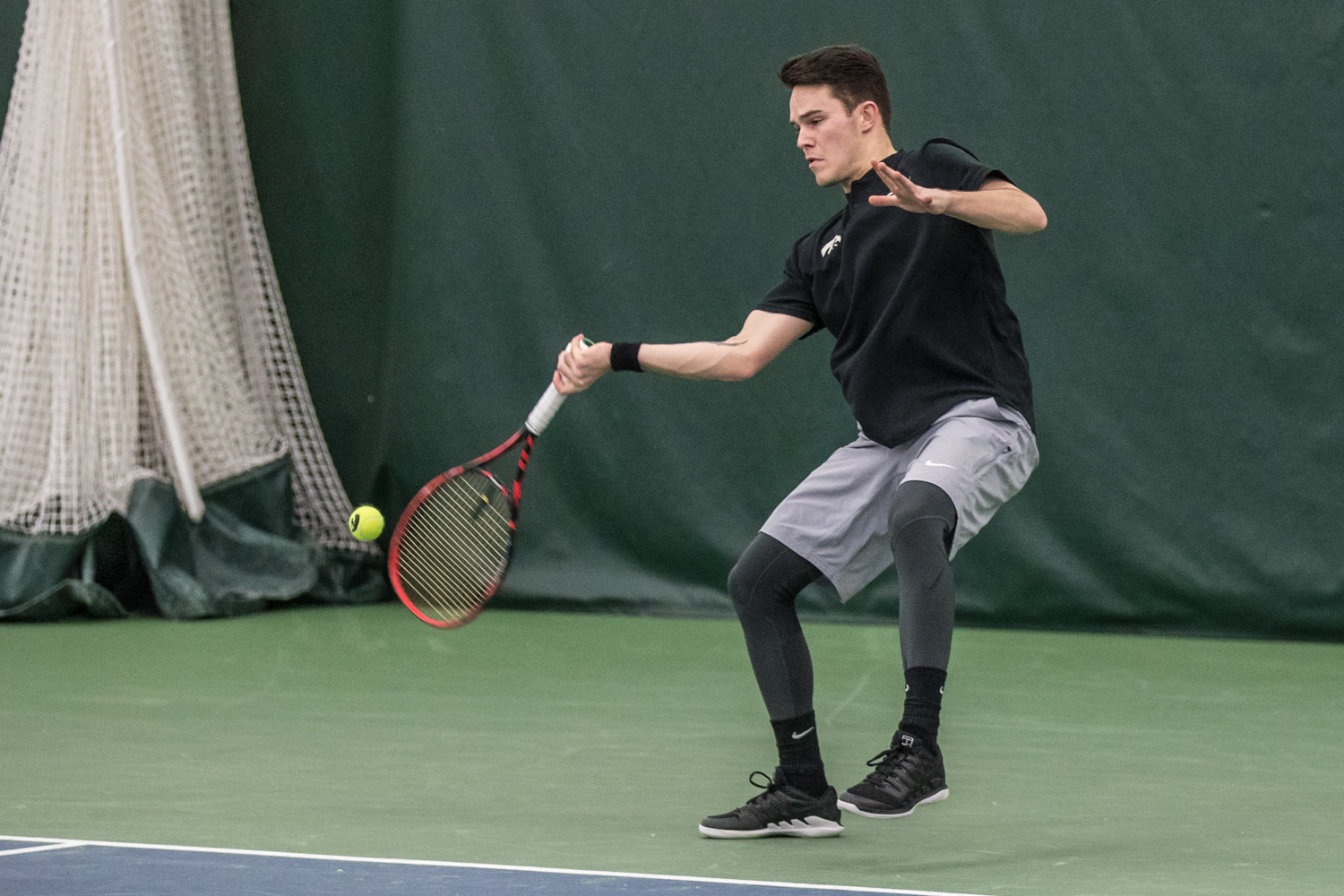 Iowa%27s+Jonas+Larsen+hits+a+forehand+during+a+men%27s+tennis+match+between+Iowa+and+East+Tennessee+State+on+Friday%2C+January+25%2C+2019.+The+Hawkeyes+defeated+the+Buccaneers%2C+4-3.