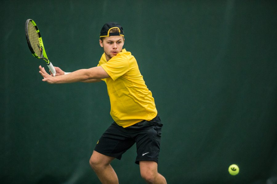 Iowa%27s+Will+Davies+hits+a+forehand+during+a+men%27s+tennis+matchup+between+Iowa+and+Butler+on+Sunday%2C+January+27%2C+2019.+The+Hawkeyes+defeated+the+Bulldogs%2C+5-2.