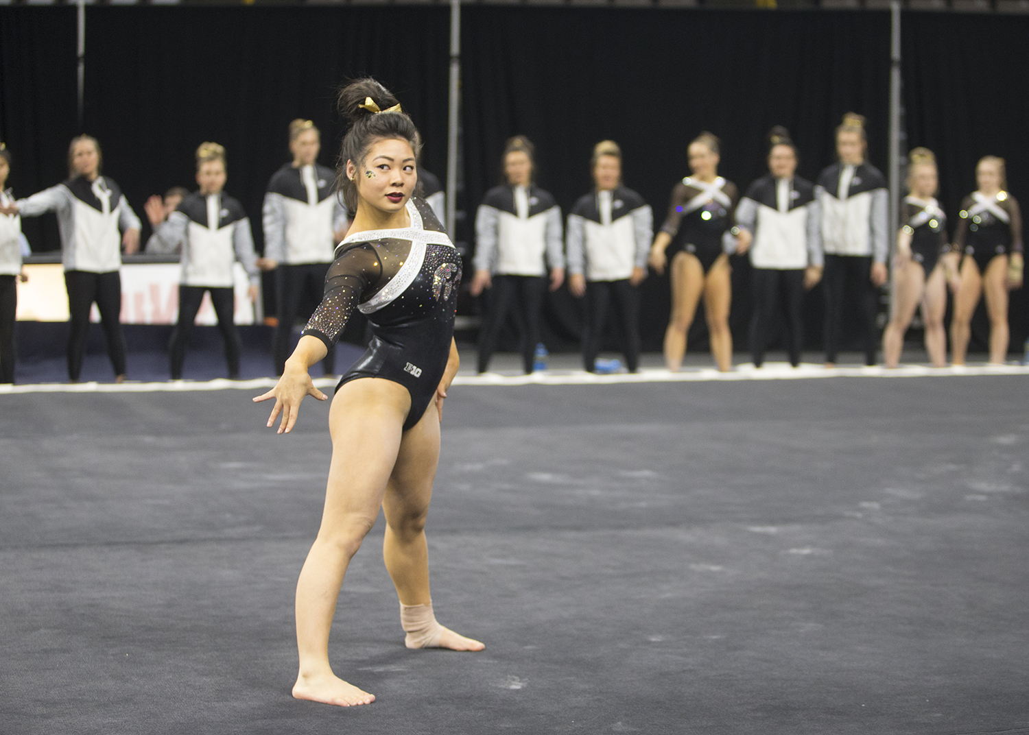Iowa gymnast Clair Kaji competes on the floor at a meet  against Rutgers on Saturday, January 26, 2019. The Hawkeyes defeated the Scarlet Knights 194.575 to 191.675.