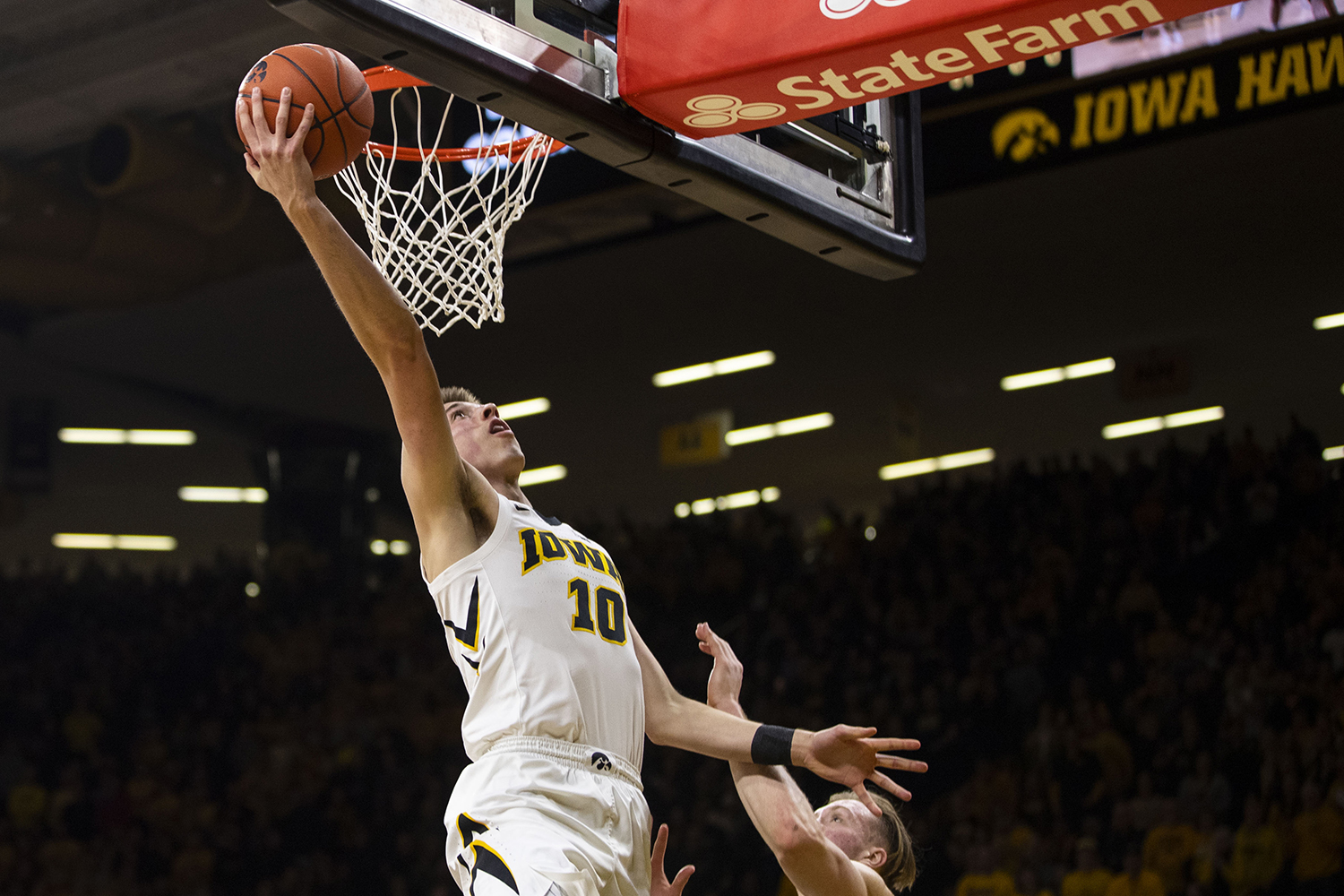Iowa+guard+Joe+Wieskamp+attempts+a+layup+during+the+Iowa%2FMichigan+men%27s+basketball+game+at+Carver-Hawkeye+Arena+on+Friday%2C+February+1%2C+2019.+The+Hawkeyes+took+down+the+No.+5+ranked+Wolverines%2C+74-59.+