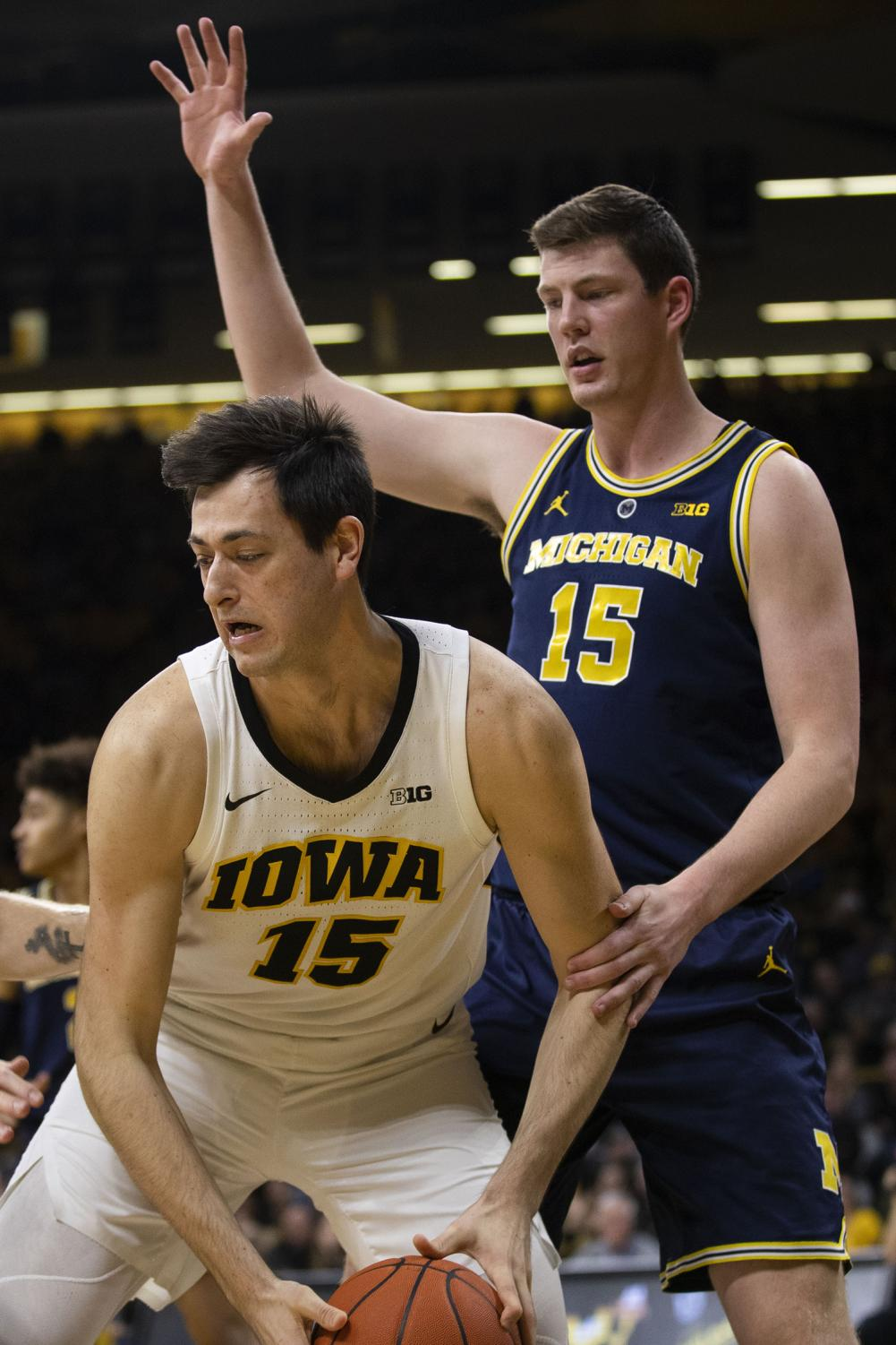 Iowa+forward+Ryan+Kriener+guards+the+ball+from+Michigan+center+Jon+Teske+during+the+Iowa%2FMichigan+men%27s+basketball+game+at+Carver-Hawkeye+Arena+on+Friday%2C+February+1%2C+2019.+The+Hawkeyes+took+down+the+No.+5+ranked+Wolverines%2C+74-59.