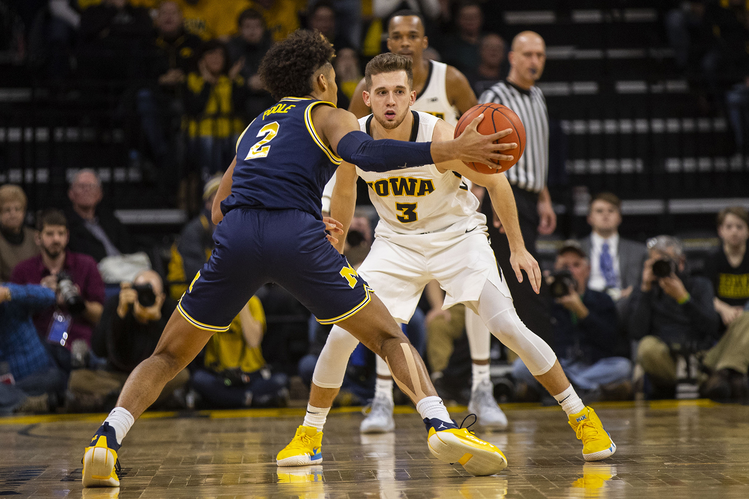 Iowa+guard+Jordan+Bohannon+eyes+the+ball+in+Michigan+guard+Jordan+Poole%27s+hand+during+the+Iowa%2FMichigan+men%27s+basketball+game+at+Carver-Hawkeye+Arena+on+Friday%2C+February+1%2C+2019.+The+Hawkeyes+took+down+the+No.+5+ranked+Wolverines%2C+74-59.+