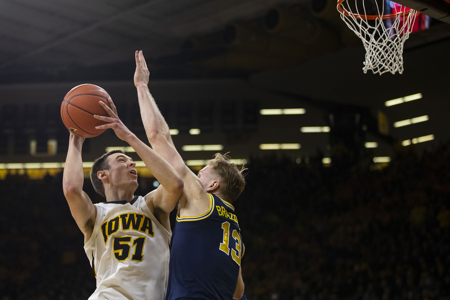 Iowa+forward+Nicholas+Baer+attempts+a+shot+during+the+Iowa%2FMichigan+men%27s+basketball+game+at+Carver-Hawkeye+Arena+on+Friday%2C+February+1%2C+2019.+The+Hawkeyes+took+down+the+No.+5+ranked+Wolverines%2C+74-59.+