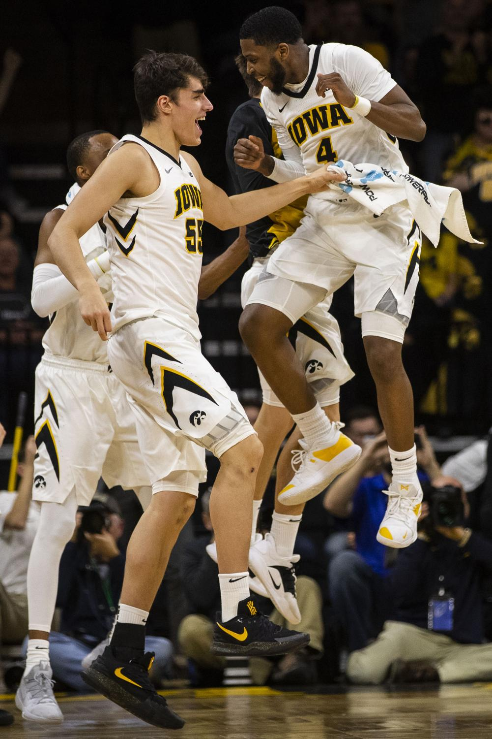 Iowa+forward+Luka+Garza+%2855%29+and+guard+Isaiah+Moss+%284%29+celebrate+during+the+Iowa%2FMichigan+men%27s+basketball+game+at+Carver-Hawkeye+Arena+on+Friday%2C+February+1%2C+2019.+The+Hawkeyes+took+down+the+No.+5+ranked+Wolverines%2C+74-59.+