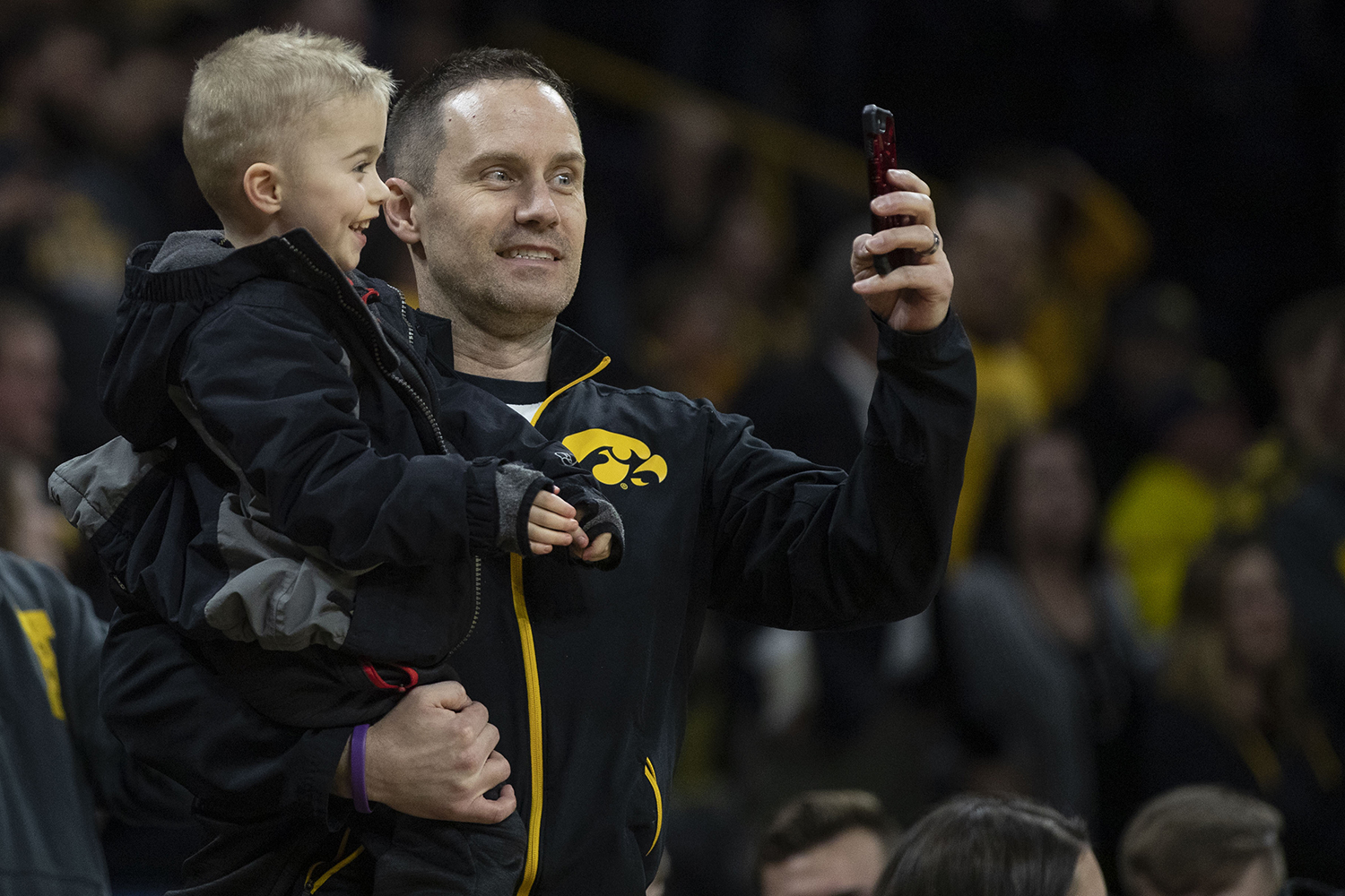 Iowa+fans+snap+a+selfie+during+the+Iowa%2FMichigan+men%27s+basketball+game+at+Carver-Hawkeye+Arena+on+Friday%2C+February+1%2C+2019.+The+Hawkeyes+took+down+the+No.+5+ranked+Wolverines%2C+74-59.+