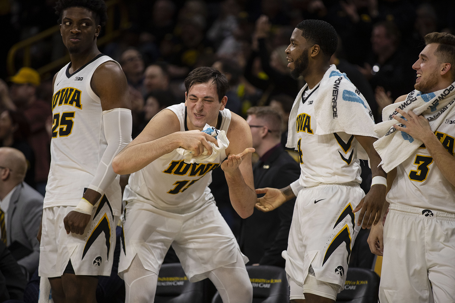 Iowa+forward+Ryan+Kriener+%2815%2C+second+from+left%29+%22eats%22+in+celebration+during+the+Iowa%2FMichigan+men%27s+basketball+game+at+Carver-Hawkeye+Arena+on+Friday%2C+February+1%2C+2019.+The+Hawkeyes+took+down+the+No.+5+ranked+Wolverines%2C+74-59.+