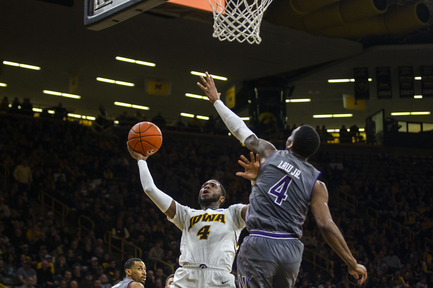 Iowa+guard+Isaiah+Moss+attempts+a+layup++during+the+Iowa%2FNorthwestern+men%27s+basketball+game+at+Carver-Hawkeye+Arena+on+Sunday%2C+February+10%2C+2019.+The+Hawkeyes+defeated+the+Wildcats%2C+80-79.+