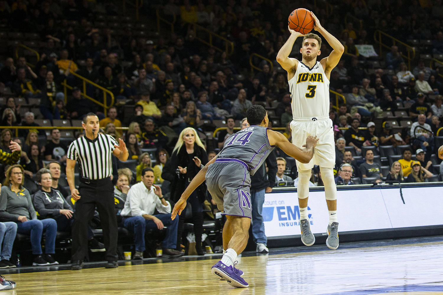 Iowa guard Jordan Bohannon attempts a 3-pointer during the Iowa/Northwestern men's basketball game at Carver-Hawkeye Arena on Sunday, February 10, 2019.