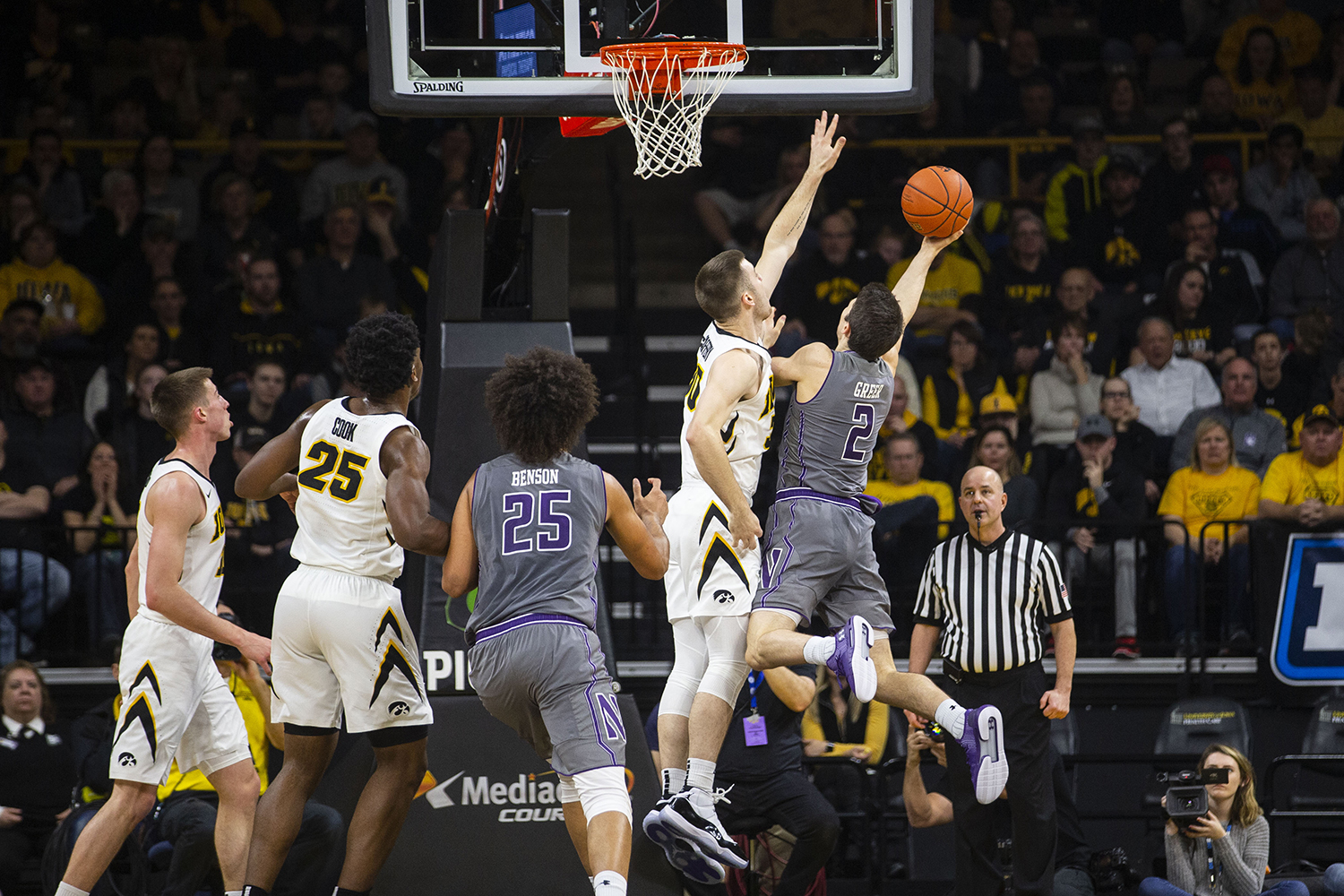 Iowa+guard+Connor+McCaffery+attempts+to+block+Northwestern+guard+Ryan+Greer%27s+shot++during+the+Iowa%2FNorthwestern+men%27s+basketball+game+at+Carver-Hawkeye+Arena+on+Sunday%2C+February+10%2C+2019.+The+Hawkeyes+defeated+the+Wildcats%2C+80-79.+