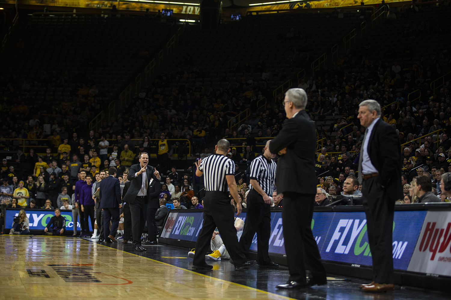 Northwestern+head+coach+Chris+Collins+%28left%29+speaks+to+referees++during+the+Iowa%2FNorthwestern+men%27s+basketball+game+at+Carver-Hawkeye+Arena+on+Sunday%2C+February+10%2C+2019.+The+Hawkeyes+defeated+the+Wildcats%2C+80-79.+