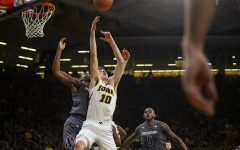 Iowa guard Joe Wieskamp to grab a rebound during the Iowa/Northwestern men's basketball game at Carver-Hawkeye Arena on Sunday, February 10, 2019. The Hawkeyes defeated the Wildcats, 80-79.