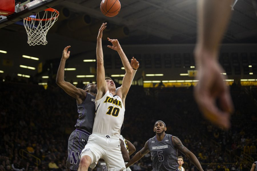 Iowa+guard+Joe+Wieskamp+to+grab+a+rebound+during+the+Iowa%2FNorthwestern+men%27s+basketball+game+at+Carver-Hawkeye+Arena+on+Sunday%2C+February+10%2C+2019.+The+Hawkeyes+defeated+the+Wildcats%2C+80-79.+