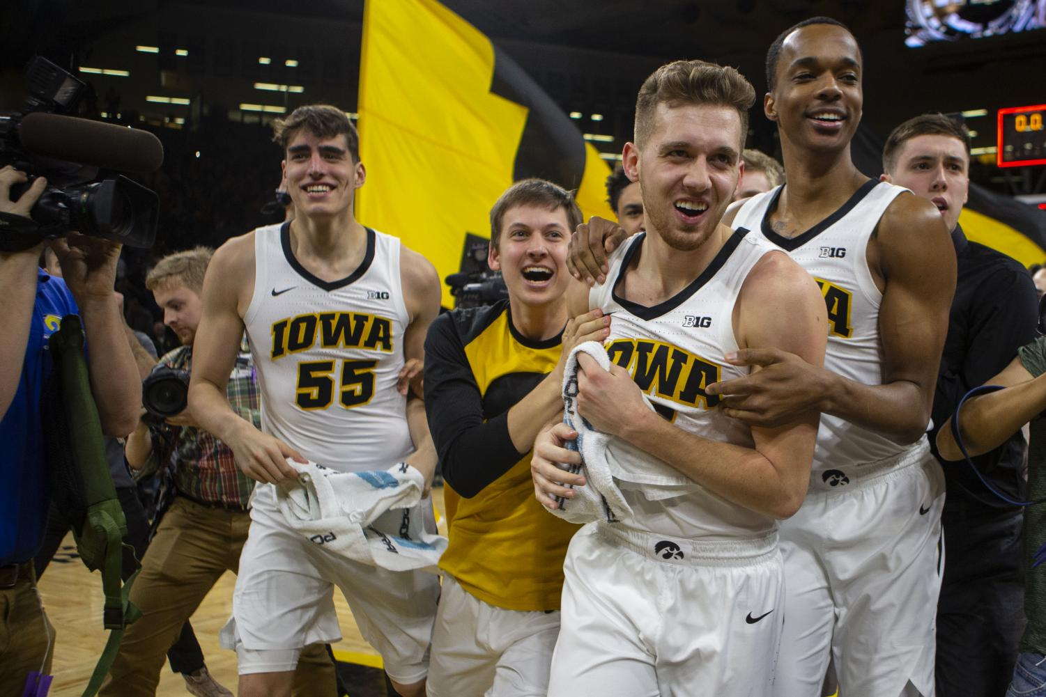 Iowa guard Jordan Bohannon celebrates with teammates after scoring the winning 3-pointer the Iowa/Northwestern men's basketball game at Carver-Hawkeye Arena on Sunday, February 10, 2019. The Hawkeyes defeated the Wildcats, 80-79.