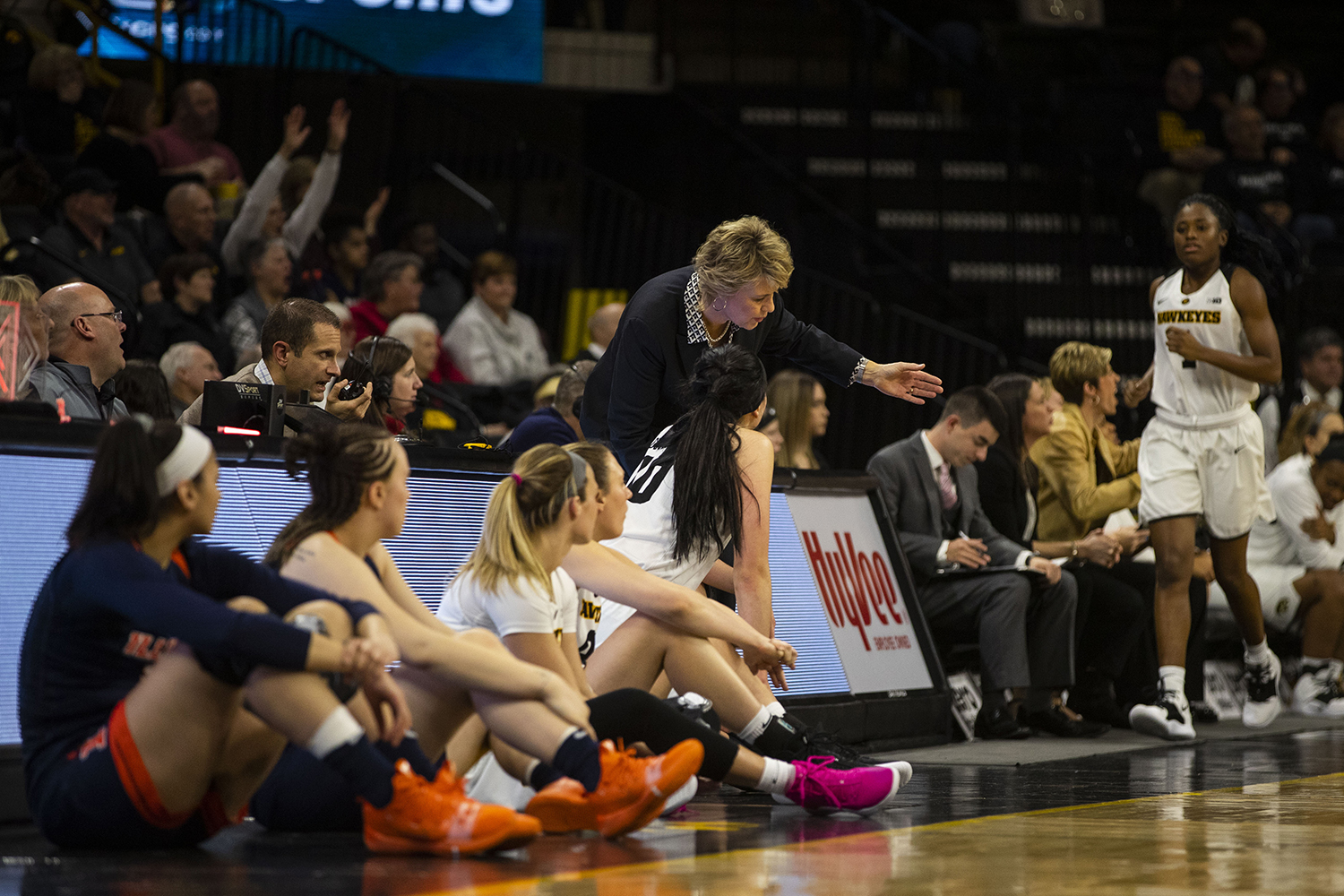 Iowa head coach Lisa Bluder (top center) gestures in conversation with center Megan Gustafson (bottom center) during the Iowa/Illinois women's basketball game at Carver-Hawkeye Arena on Thursday, February 14, 2019. The Hawkeyes defeated the Fighting Illini, 88-66.