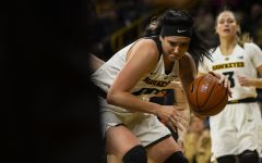 Iowa center Megan Gustafson drives to the basket during the Iowa/Illinois women's basketball game at Carver-Hawkeye Arena on Thursday, February 14, 2019. The Hawkeyes defeated the Fighting Illini, 88-66.