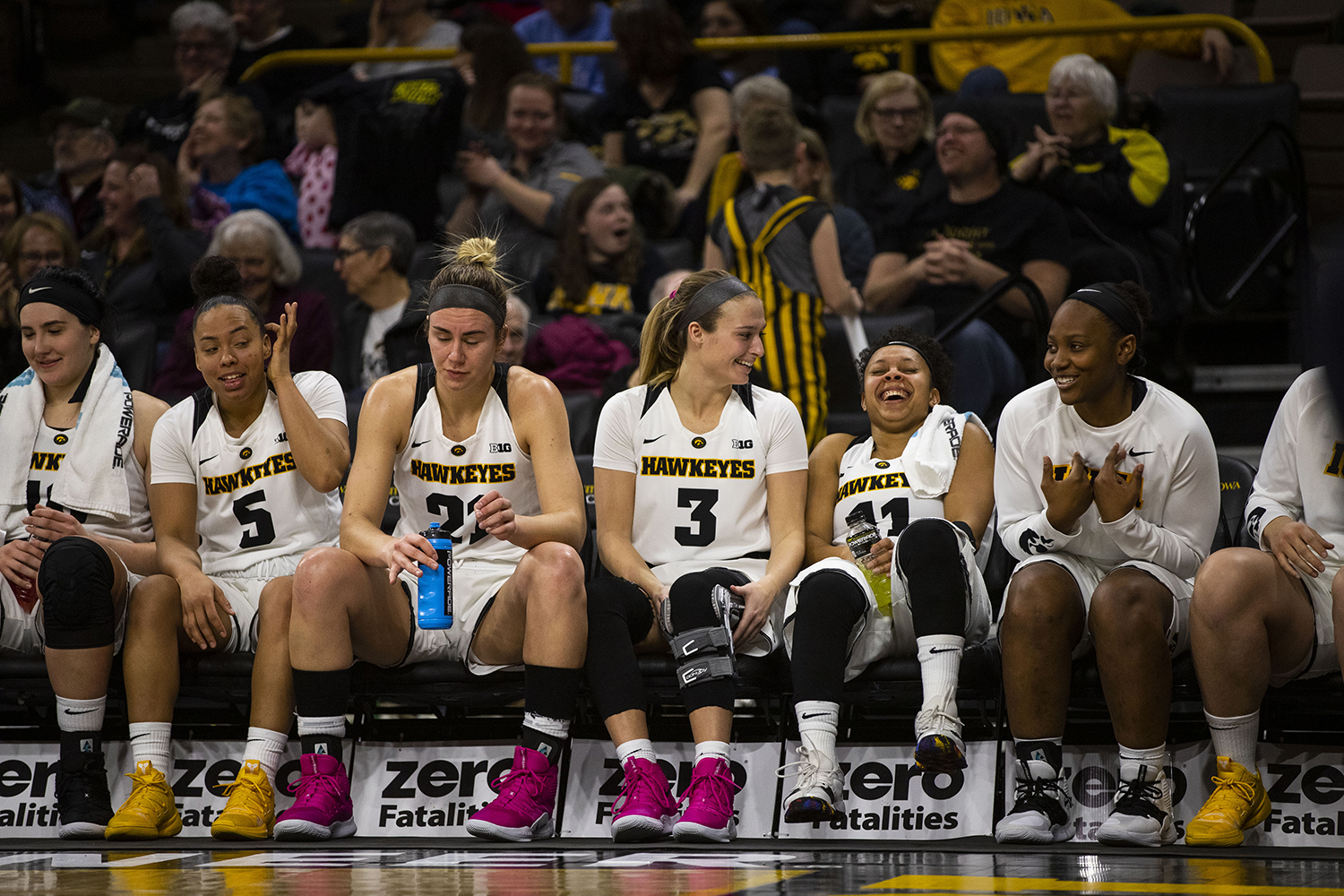 Iowa+players+react+to+a+video+of+them+singing+%22I+Will+Always+Love+You%22+by+Whitney+Houston+being+shown+on+the+big+screen+during+the+Iowa%2FIllinois+women%27s+basketball+game+at+Carver-Hawkeye+Arena+on+Thursday%2C+February+14%2C+2019.+The+Hawkeyes+defeated+the+Fighting+Illini%2C+88-66.+