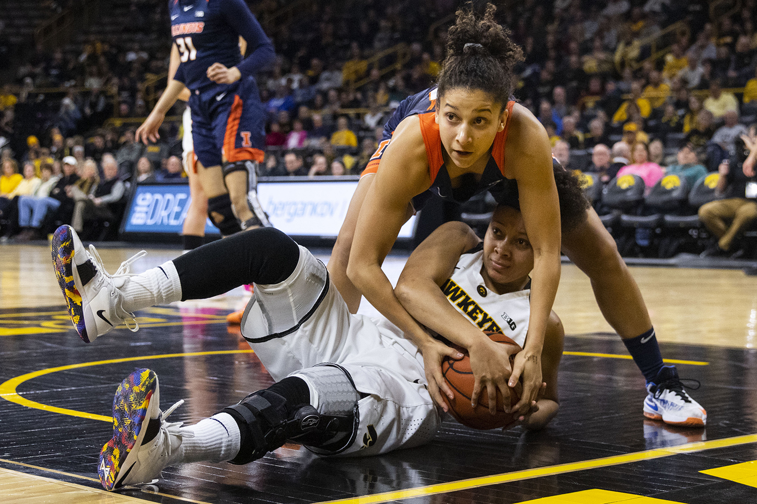 Iowa+guard+Tania+Davis+fights+for+control+of+the+ball+with+Illinois+guard+Jaelyne+Kirkpatrick+during+the+Iowa%2FIllinois+women%27s+basketball+game+at+Carver-Hawkeye+Arena+on+Thursday%2C+February+14%2C+2019.+The+Hawkeyes+defeated+the+Fighting+Illini%2C+88-66.+