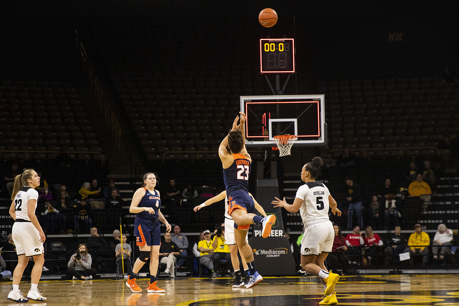 Illinois%27+guard+Jaelyne+Kirkpatrick+attempts+an+unsuccessful+half+court+shot+at+the+buzzer+during+the+Iowa%2FIllinois+women%27s+basketball+game+at+Carver-Hawkeye+Arena+on+Thursday%2C+February+14%2C+2019.+The+Hawkeyes+defeated+the+Fighting+Illini%2C+88-66.+