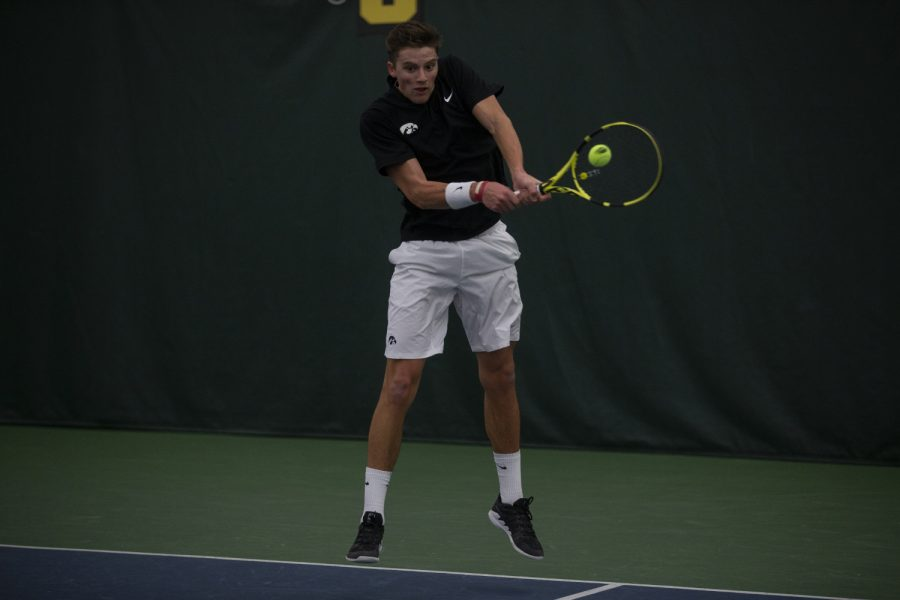 Joe+Tyler+hits+the+ball+during+men%27s+tennis+against+the+University+of+Nebraska+Omaha+at+the+Hawkeye+Tennis+and+Recreation+Complex+on+Feb.+15%2C+2019.+The+hawkeyes+defeated+Omaha+5-2.+Tyler+lost+his+single%27s+match+against+Omaha%27s+Davis+Lawley.+