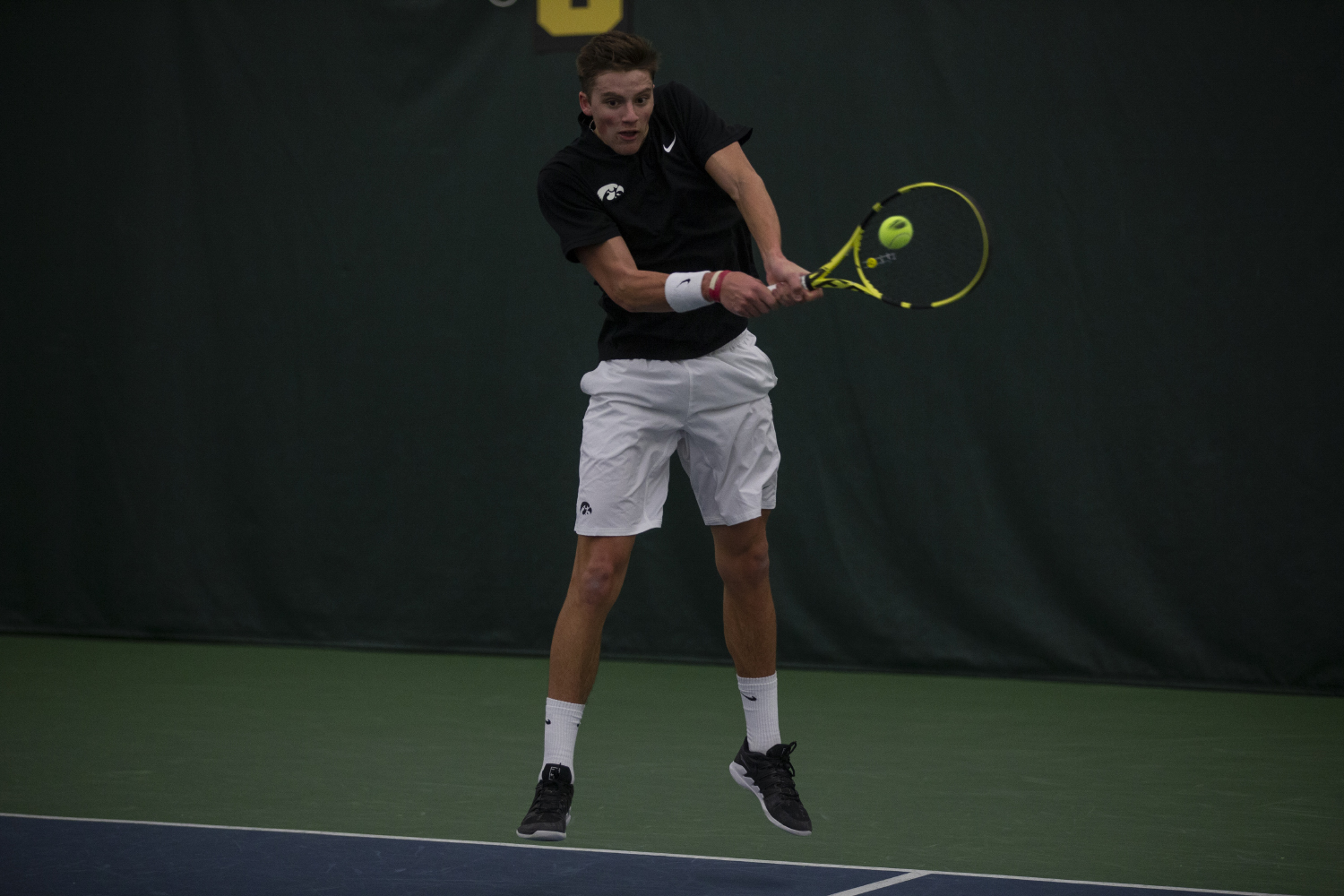 Joe Tyler hits the ball during men's tennis against the University of Nebraska Omaha at the Hawkeye Tennis and Recreation Complex on Feb. 15, 2019. The hawkeyes defeated Omaha 5-2. Tyler lost his single's match against Omaha's Davis Lawley.