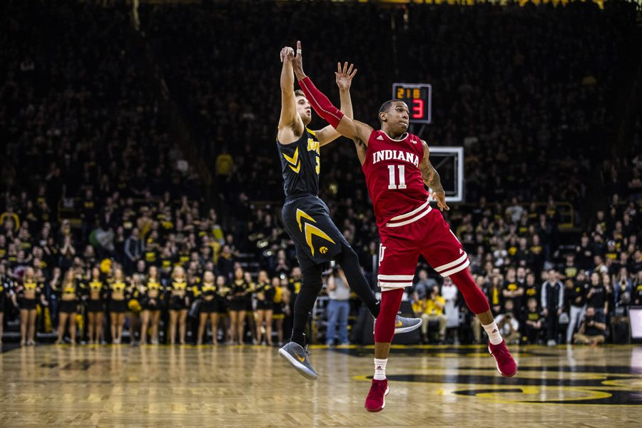 Iowa+guard+Jordan+Bohannon+shoots+the+ball+past+Indiana+guard+Devonte+Green+during+men%27s+basketball+vs.+Indiana+at+Carver-Hawkeye+Arena+on+Friday%2C+February+22%2C+2019.+The+Hawkeyes+defeated+the+Hoosiers+76-70.+%28Katina+Zentz%2FThe+Daily+Iowan%29