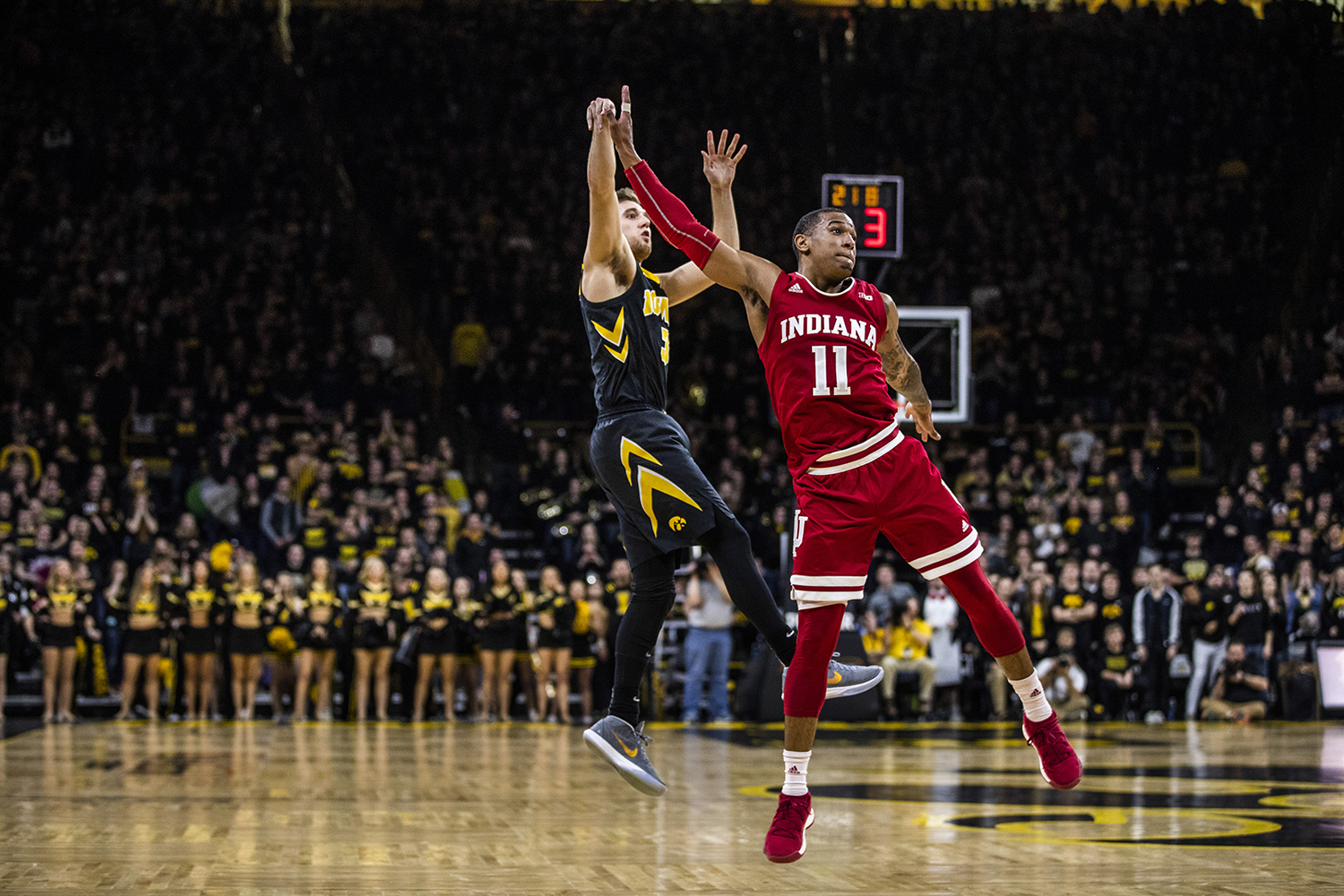 Iowa guard Jordan Bohannon shoots the ball past Indiana guard Devonte Green during men's basketball vs. Indiana at Carver-Hawkeye Arena on Friday, February 22, 2019. The Hawkeyes defeated the Hoosiers 76-70. (Katina Zentz/The Daily Iowan)
