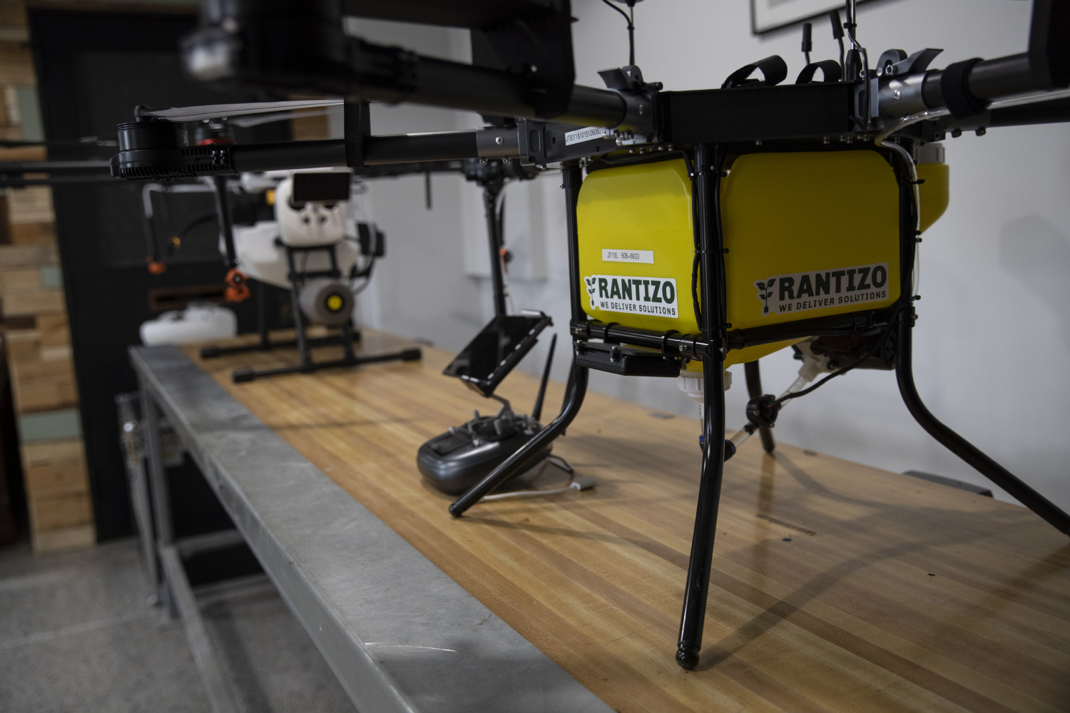 Rantizo+drones+sit+on+display+during+Lt.+Gov.+Adam+Gregg%27s+visit+with+Rantizo+in+downtown+Iowa+City+on+Feb.+25%2C+2019.+Rantizo+is+an+agricultural+start-up+that+uses+drones+to+spray+agrochemicals+by+spotting+certain+areas+with+anomalies.+