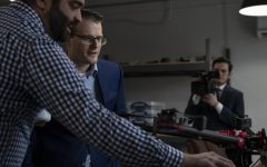 Lieutenant Governor Adam Gregg (right) is shown drones by Technology Director with Rantizo Mike Schmitz during  Gregg's visit with Rantizo in downtown Iowa City on Feb. 25, 2019. Rantizo is an agricultural start-up that uses drones to spray agrochemicals by spotting certain areas with anomalies. Lt. Governor Gregg visits with Rantizo as a part of the governor's 99 county tour. (Katie Goodale/The Daily Iowan).