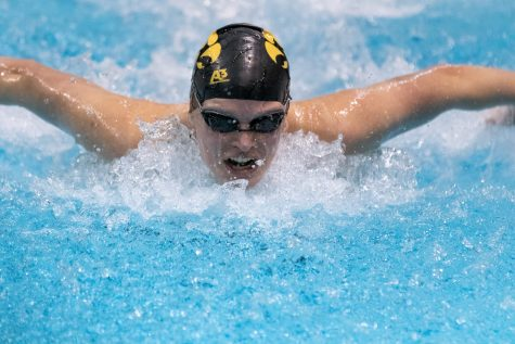Iowa swimmer Kelsey Drake swims the 100m butterfly during a swim meet against the University of Northern Iowa and Western Illinois University on Friday, Feb. 1, 2019.