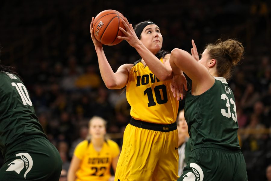 Iowa+forward+Megan+Gustafson+%2810%29+looks+for+a+shot+during+a+basketball+game+against+Michigan+State+on+Thursday%2C+Feb.+7%2C+2019.+The+Hawkeyes+defeated+the+Spartans+86-71.+