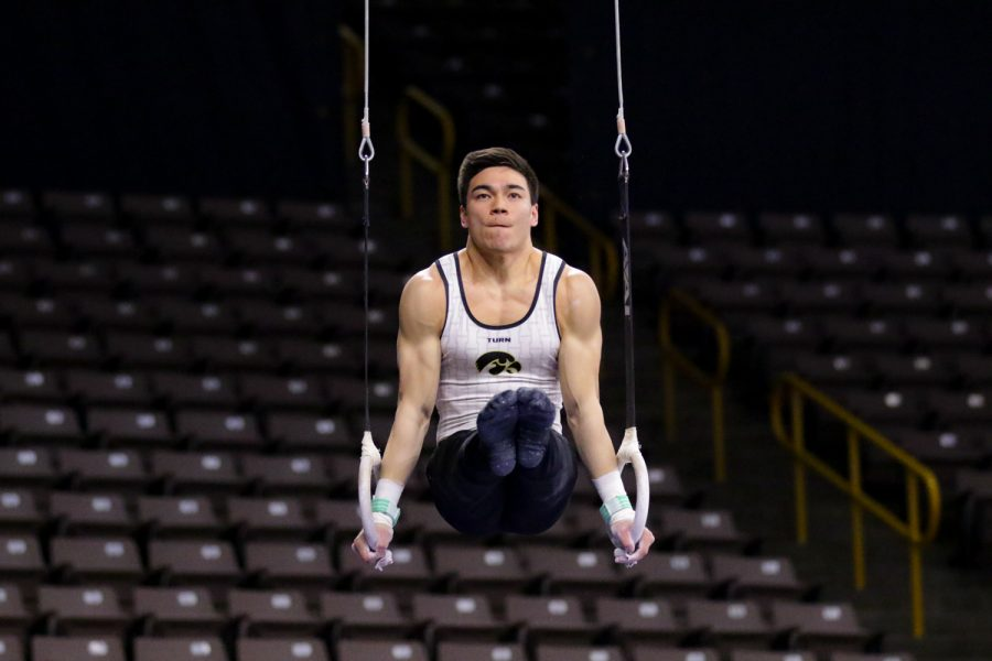Iowa gymnast Brandon Wong performs on the rings during a gymnastics meet against Minnesota and Illinois-Chicago on Saturday, Feb 2, 2019. The Golden Gophers won the meet with a total score of 406.400 with the Hawkeyes scoring 401.600 and the Flames scoring 355.750.