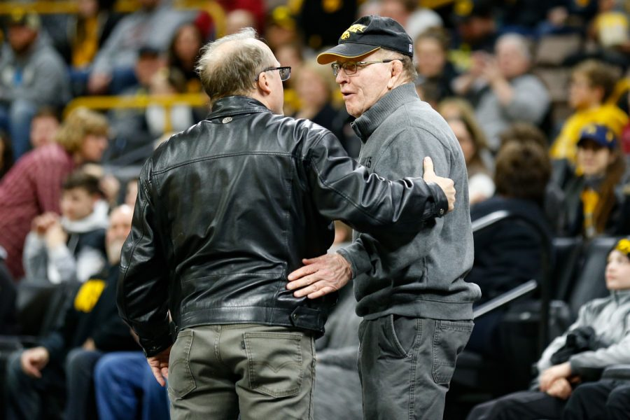 Former Iowa wrestler Barry Davis (left) talks with former Iowa wrestling head coach Dan Gable during the intermission of a wrestling dual meet between Iowa and Maryland at Carver-Hawkeye Arean on Friday, Feb. 8, 2019. The Hawkeyes defeated the Terrapins 48-0.