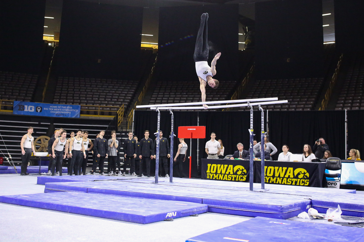 Iowa gymnast Rogelio Vazquez performs on the parallel bars during a gymnastics meet against Minnesota and Illinois-Chicago on Saturday, Feb 2, 2019. The Golden Gophers won the meet with a total score of 406.400 with the Hawkeyes scoring 401.600 and the Flames scoring 355.750.