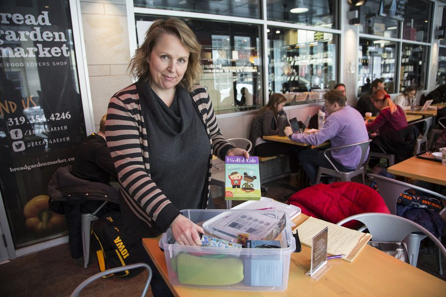 Dina Bishara, cofounder of the Iowa City Autism Community, displays the contents of a Calm Kit on Tuesday, February 26 2019 at Bread Garden Market. She plans to donate Calm Kits to local schools to help students with autism.